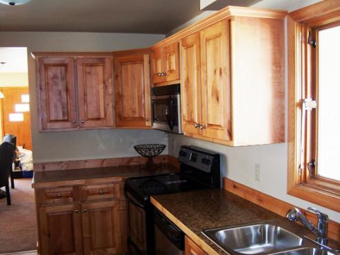 Same Wall After New Rustic Alder Cabinets U0026 Brand New Appliances. Custom  Crafted Laminate Countertop. Natural Stain.